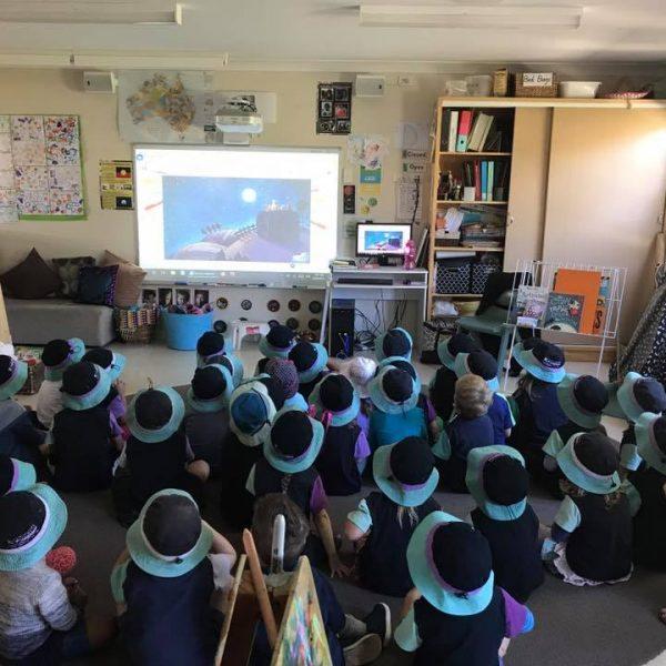 Kids inside watching interactive whiteboard