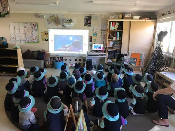 Kids inside watching interactive whiteboard